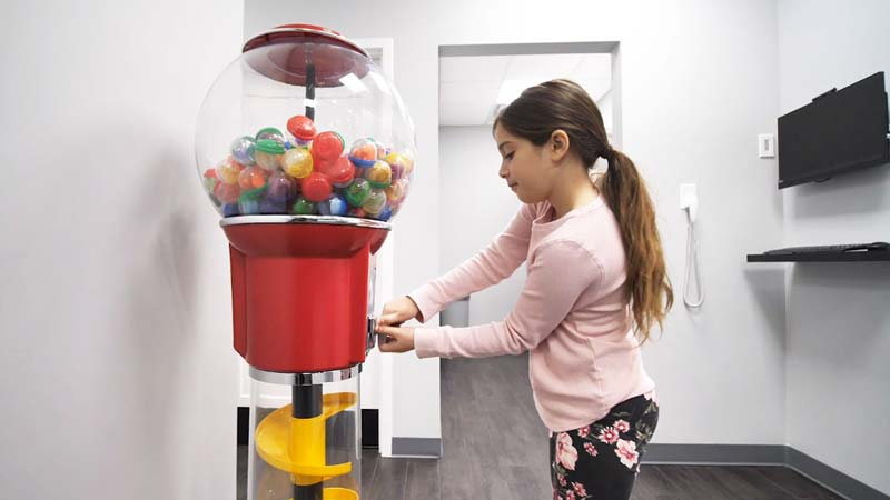 Getting Prize Out of Gumball Machine at Dentist